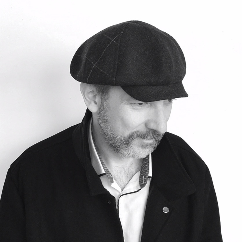 Perry is a baker boy-style cap, with a rounded feel and a short peak. A flattering design suited to square face shapes.