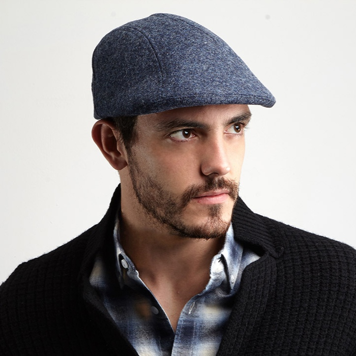 The ever-popular deep fitting Clive flat cap with its rounded outline.