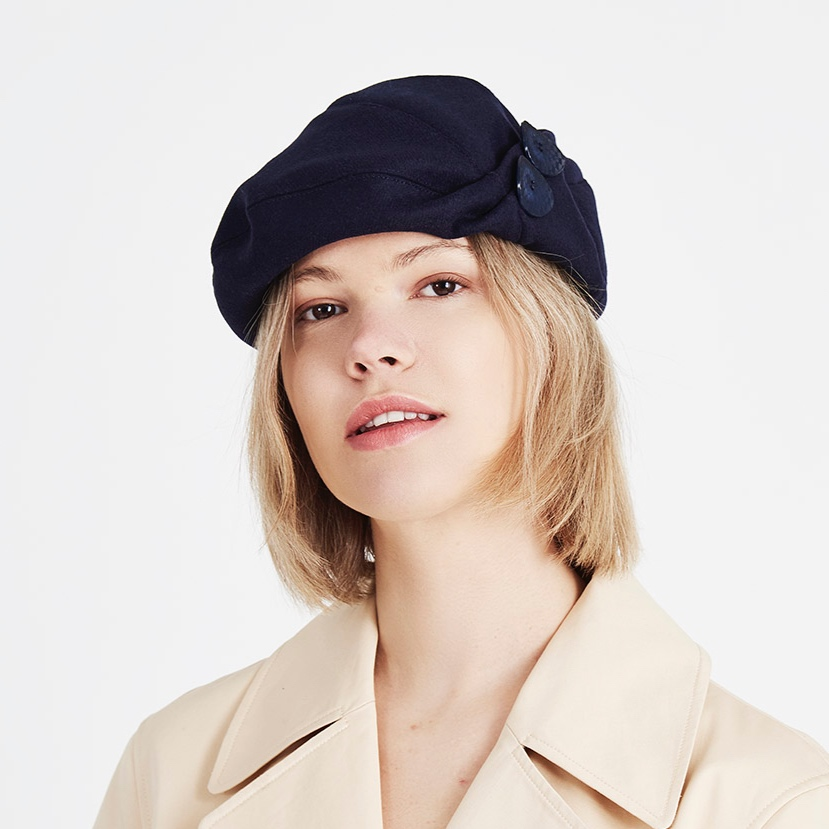 The long-time favourite beret design Bonnie is ideal for square face shapes with its flattering pleats and button detail.