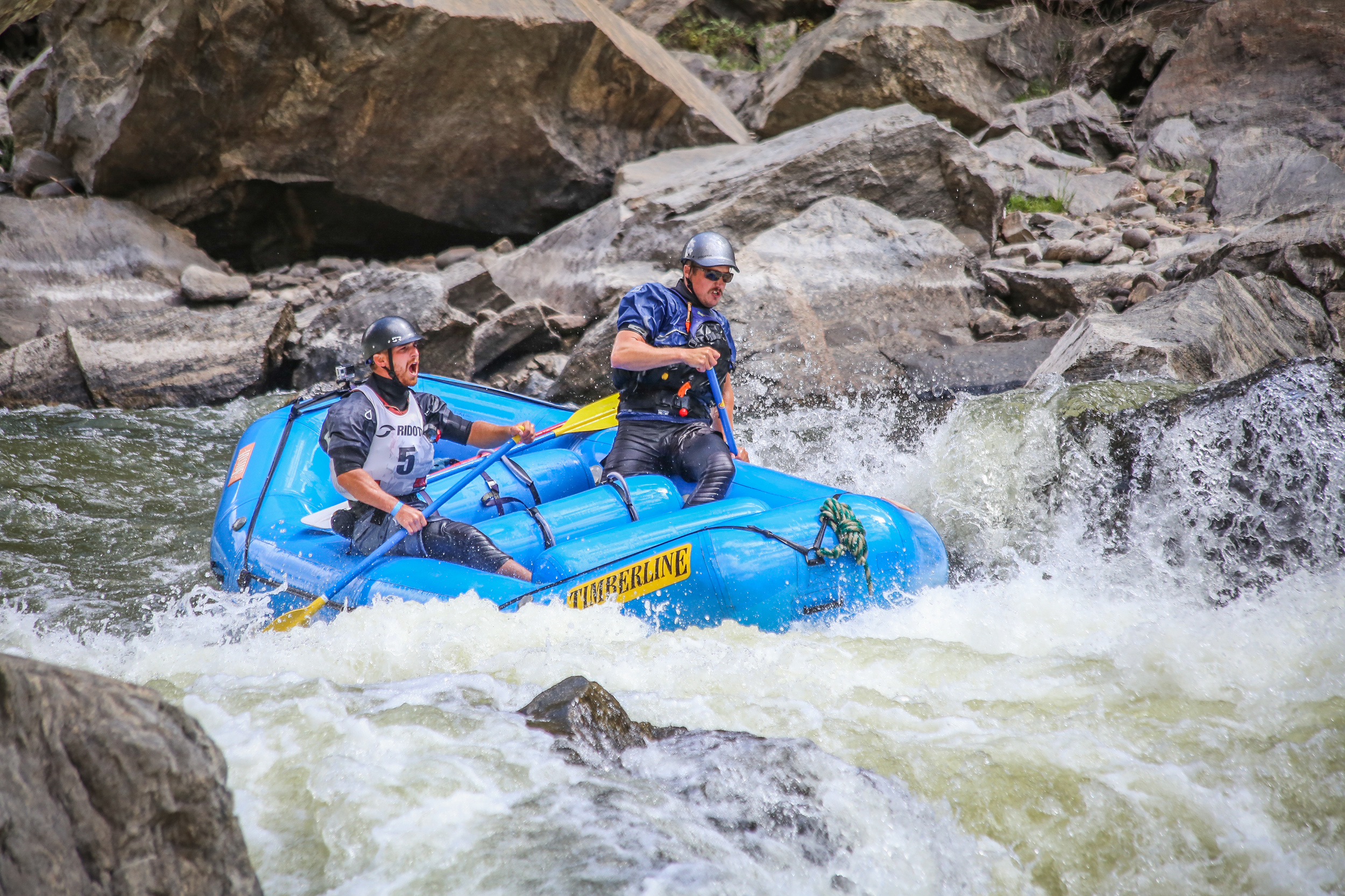 This is Shawn and Christian about to huck a 12-foot waterfall rapid called Tunnel Falls. (I was lucky enough to get taken into a the canyon by a railroad truck to photograph this spot for the race.)