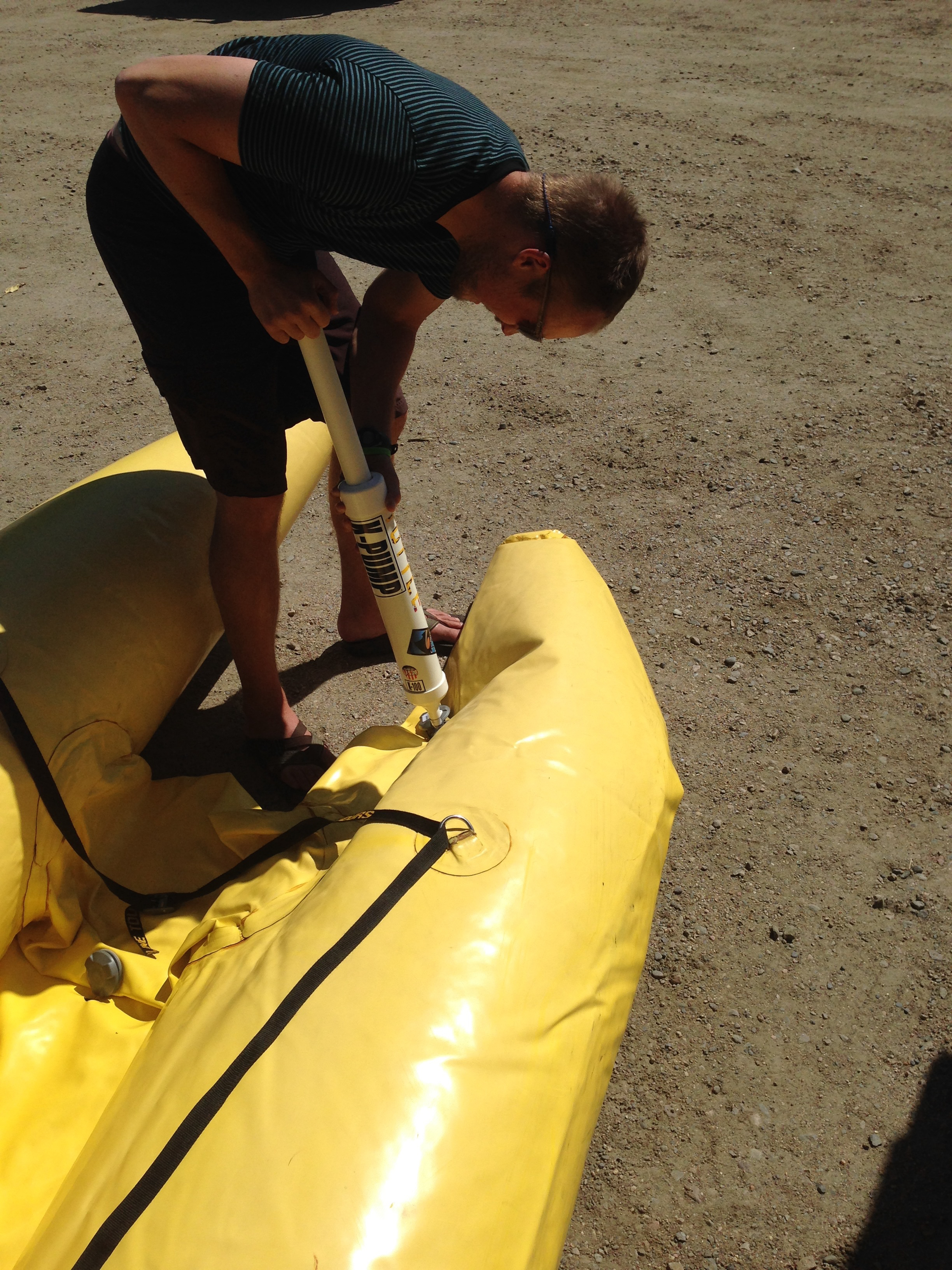 Pumping up the shredder with our hand K-pump. Thankfully, it's a small boat.