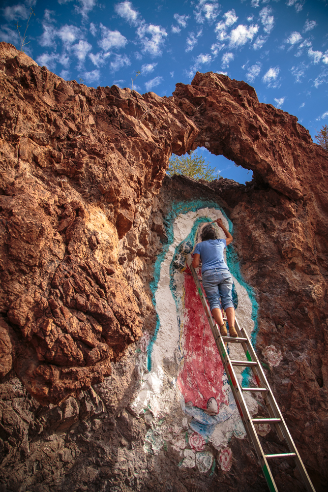 The cliff created a fantastic halo around the mural's head. The last coat of paint had been weakened by the most recent hurricane.