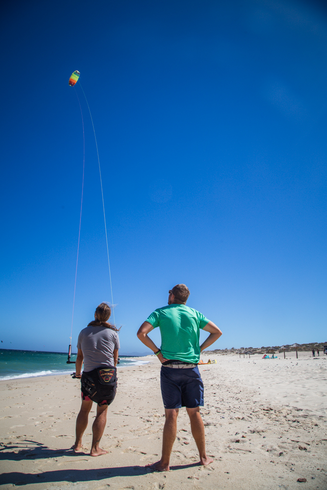 Pablo with his hands on the auxillary control bar, which slows down the control of the kite.