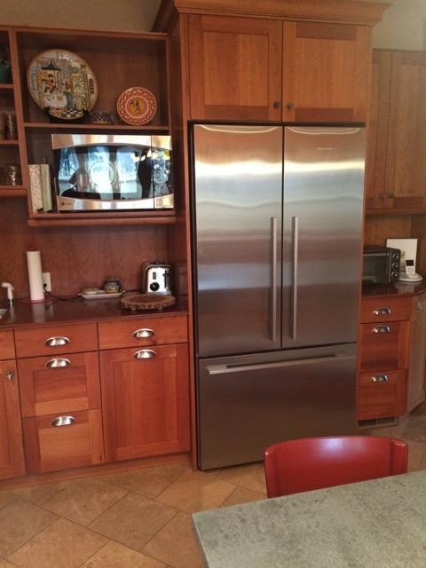 The new fridge, minus artwork.