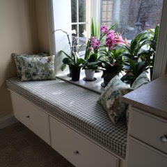 This window seat and garden serves as a transition between the master bedroom and bath.