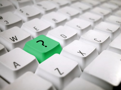 white-computer-keyboard-with-green-question-mark