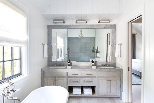 The wide mirror brings even more light into the airy, dreamlike bath of our Sag Harbor project. ⛅️  Design by @aliciamurphydesign . . . #aliciamurphydesign #custominteriors #homesweethome #luxuryliving #hamptonshome #homestyle #modernhomes #styleathome #homedecor #customdesign #designandbuild #customfurniture #creativityfound #designdetails #interiordetails #homedesign #homerenovation #flashesofdelight #cozyhome #interiorstyling #dayinthelife #interiordesignerlife #nycinteriordesign #customhomes #customlifestyle #homestyling #luxurybedroom #luxurybathroom #dualvanities #bathroomdesign