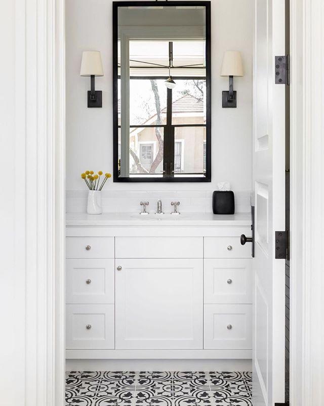 The perfect black accents to make this bathroom pop.  Via @changoandco / 📸: @selliottphoto . . . #aliciamurphydesign #custominteriors #homesweethome #luxuryliving #hamptonshome #homestyle #modernhomes #styleathome #homedecor #customdesign #designandbuild #customfurniture #creativityfound #designdetails #interiordetails #homedesign #homerenovation #flashesofdelight #cozyhome #interiorstyling #dayinthelife #interiordesignerlife #nycinteriordesign #customhomes #customlifestyle #homestyling #ihaveathingwithfloors #bathroomdesign #blackandwhitedesign #modernbathroom