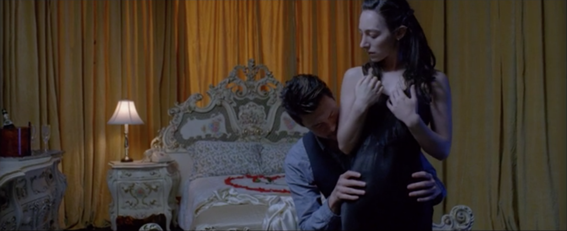 A young woman in a honeymoon suite, abandoned by her fiance, dreams of a mysterious man.  Directed by Meredith Koch  Cinematography by Tara Violet Niami