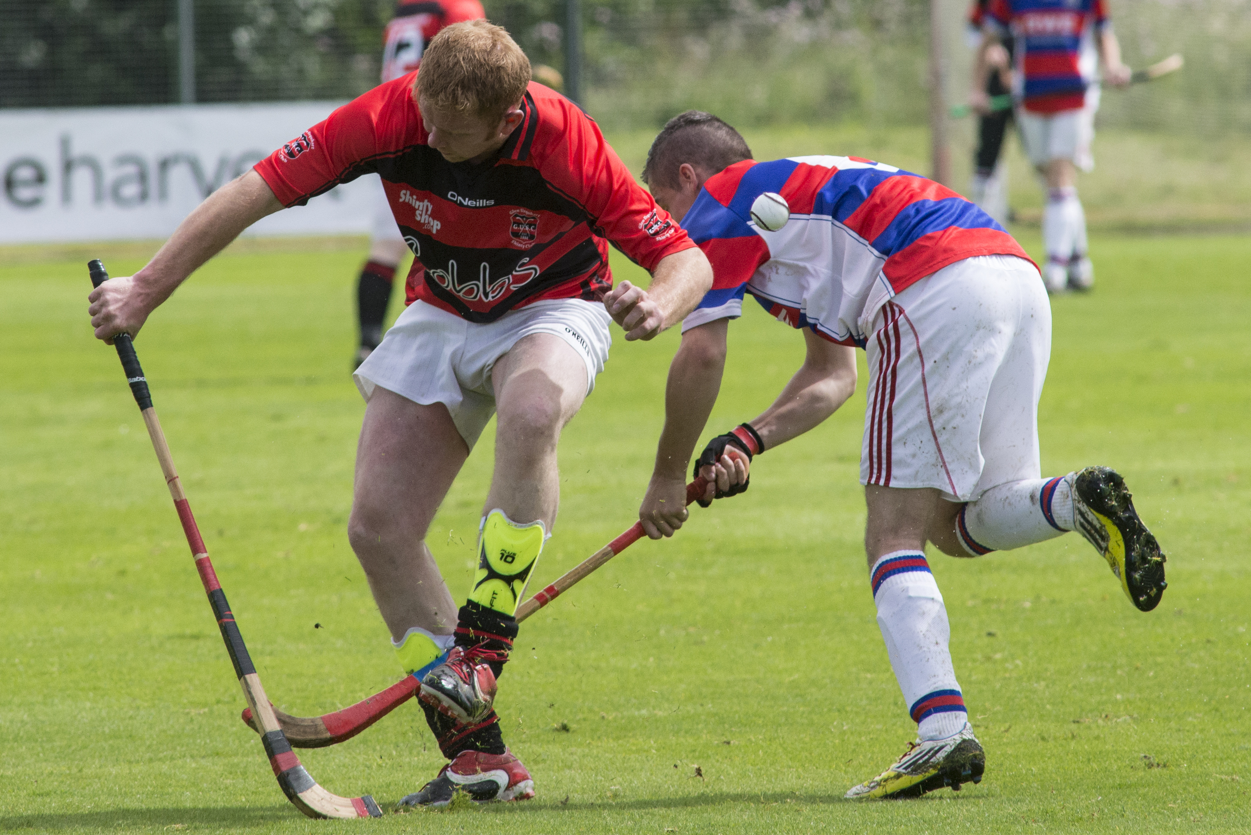 Kingussie shinty player Jake MacPherson (right) fights for control of the ball using his caman against his Glenurquhart opponent at The Dell in Kingussie, Scotland on Saturday, August 1, 2015. Shinty is unique to Scotland and one of the oldest games in the world. The Dell playing fields at Kinguisse are considered by some to be the original home of organised shinty as we know it today.