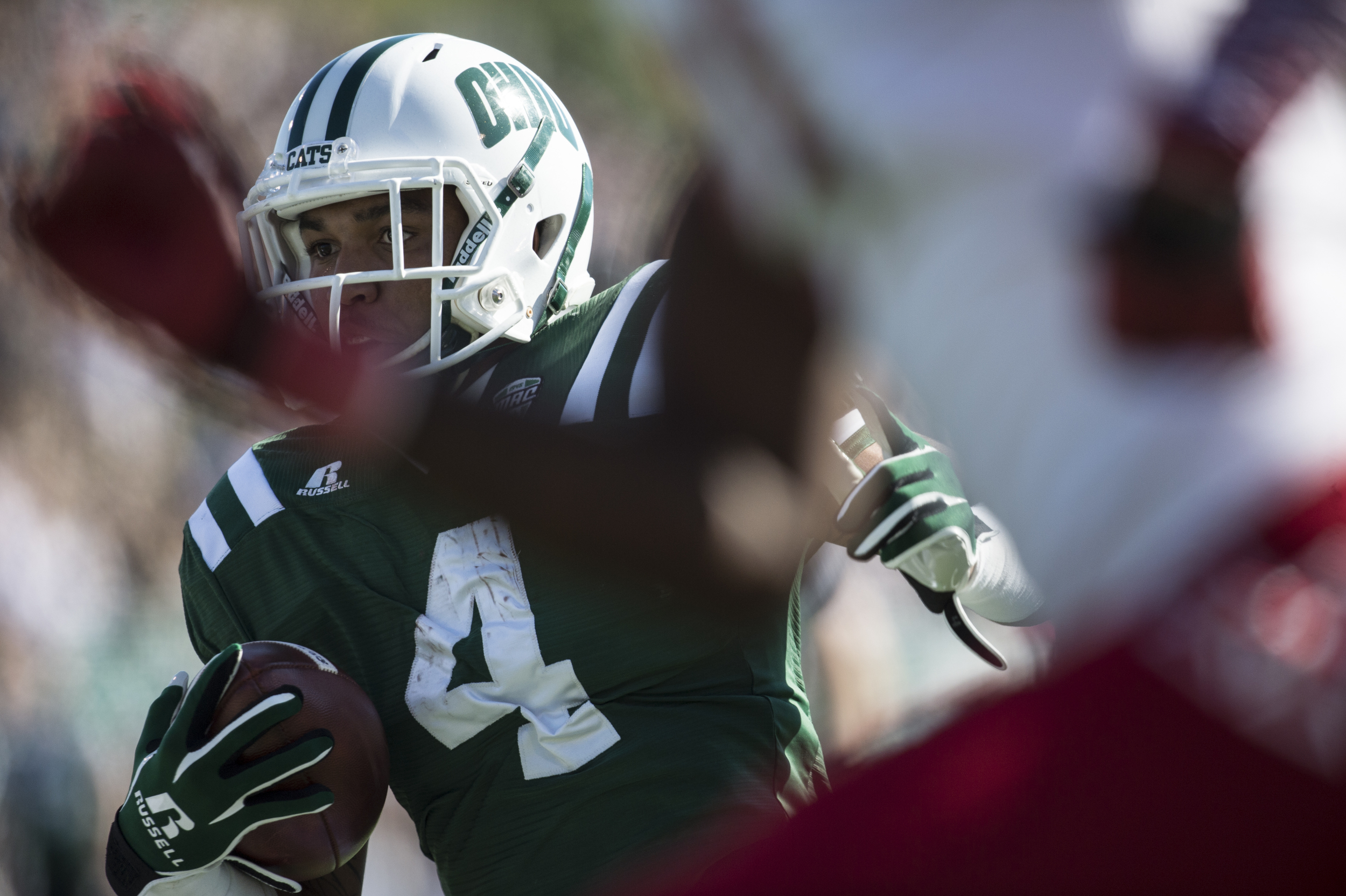 Ohio University redshirt freshman running back Papi White (#4) carries the ball for a 36 yard gain against OU's rival Miami University on Saturday, Oct. 10,2015 at Peden Stadium in Athens, Ohio. White had a career-high 75 receiving yards. The Bobcats defeated the Red Hawks 34-3 on homecoming weekend.