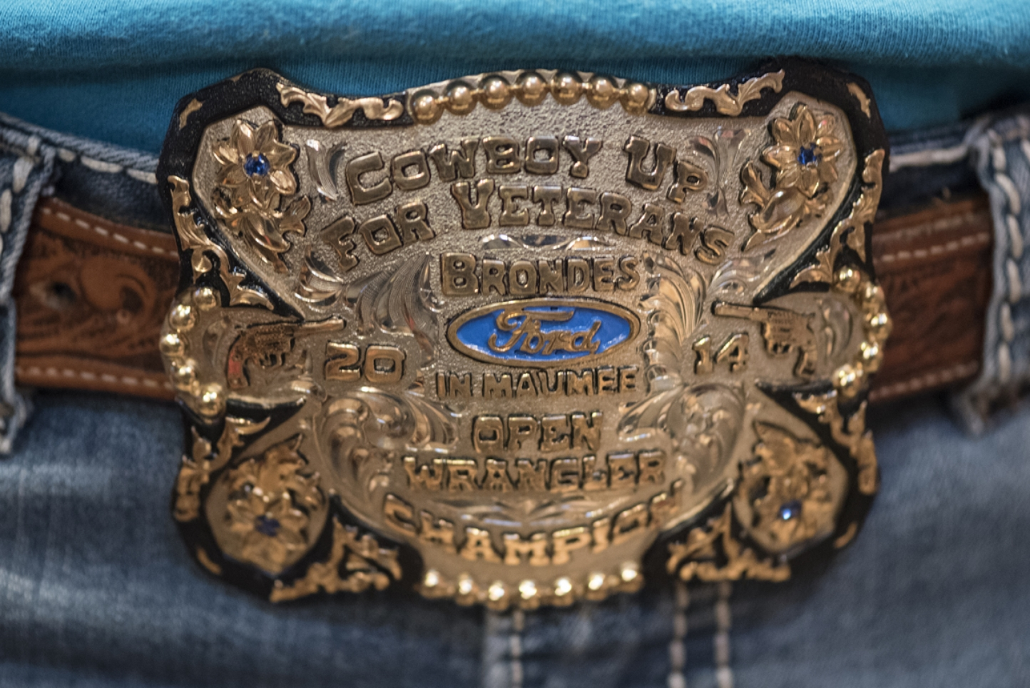 Ally Schreiber wears a belt buckle that she won at the 2014 Cowboy Up For Veterans shootout.