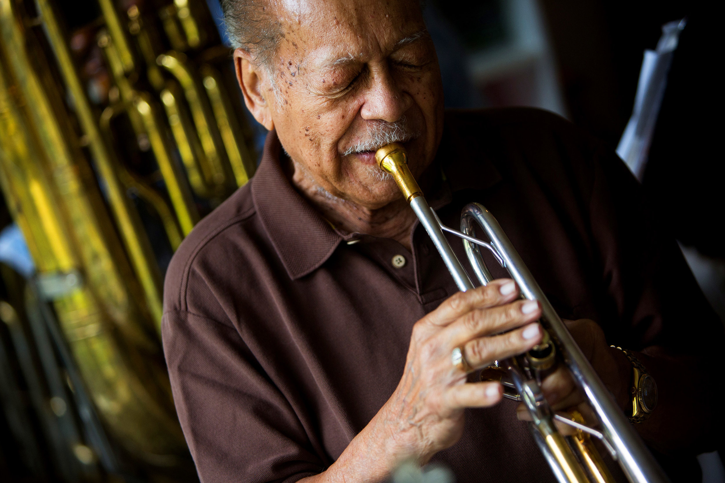 "Renald Richard, 91, plays the trumpet during a jazz jam session at the home of Jim Gover in Naples, Florida on Tuesday, Oct. 11, 2016. Richard was Ray Charles' former band leader and co-wrote his hit song ""I Got a Woman."" ""I was asked, 'Would you be interested in playing with Ray Charles?' Now that's like asking if a baby likes candy."""