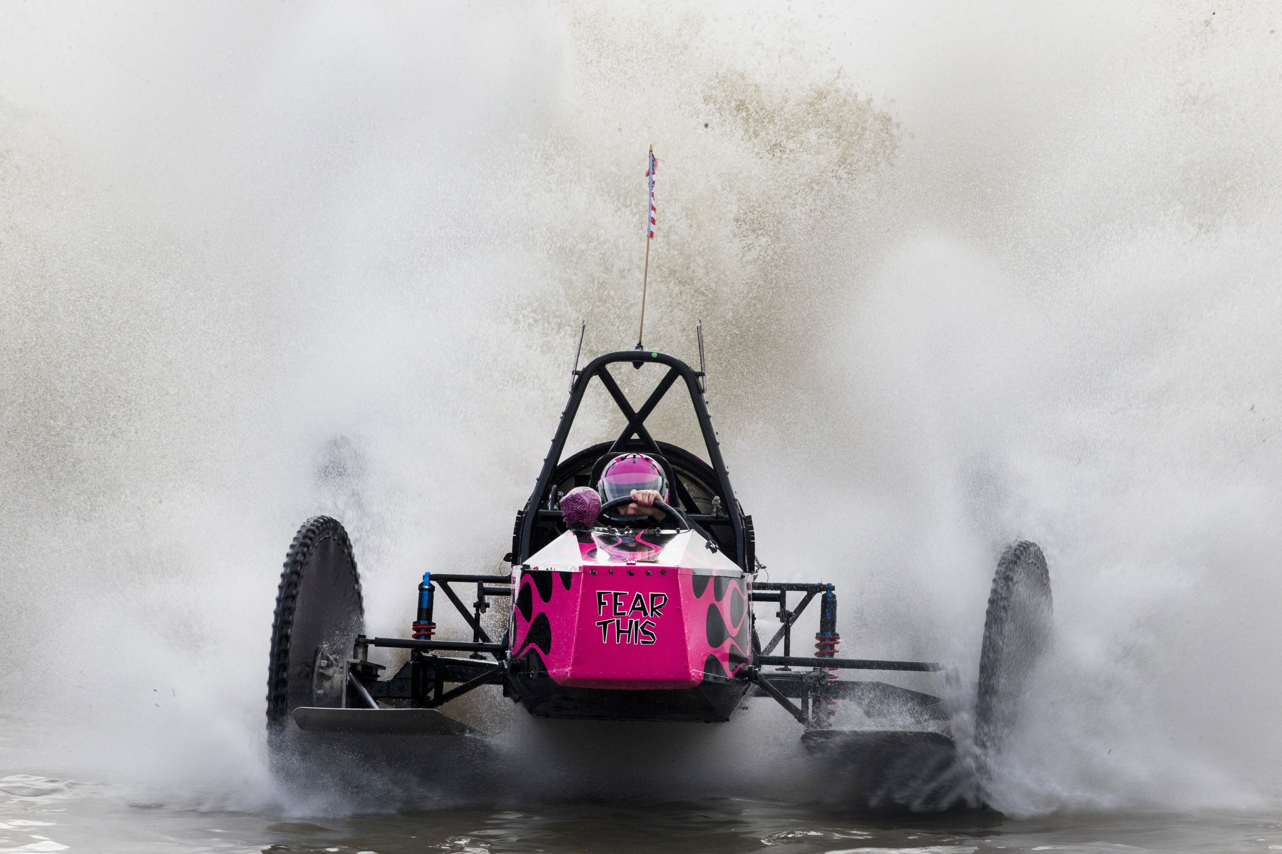 "Fatal Attraction driver Bonnie Walsh, 57, crosses the finish line to win the Big Feature in 54.35 seconds during the Budweiser Winter Classic swamp buggy races at Florida Sports Park in Naples, Florida on Sunday, Jan. 29, 2017. This weekend was her first time racing since her husband and fellow swamp buggy driver, Terry ""T-Bone"" Walsh, died in March 2016."