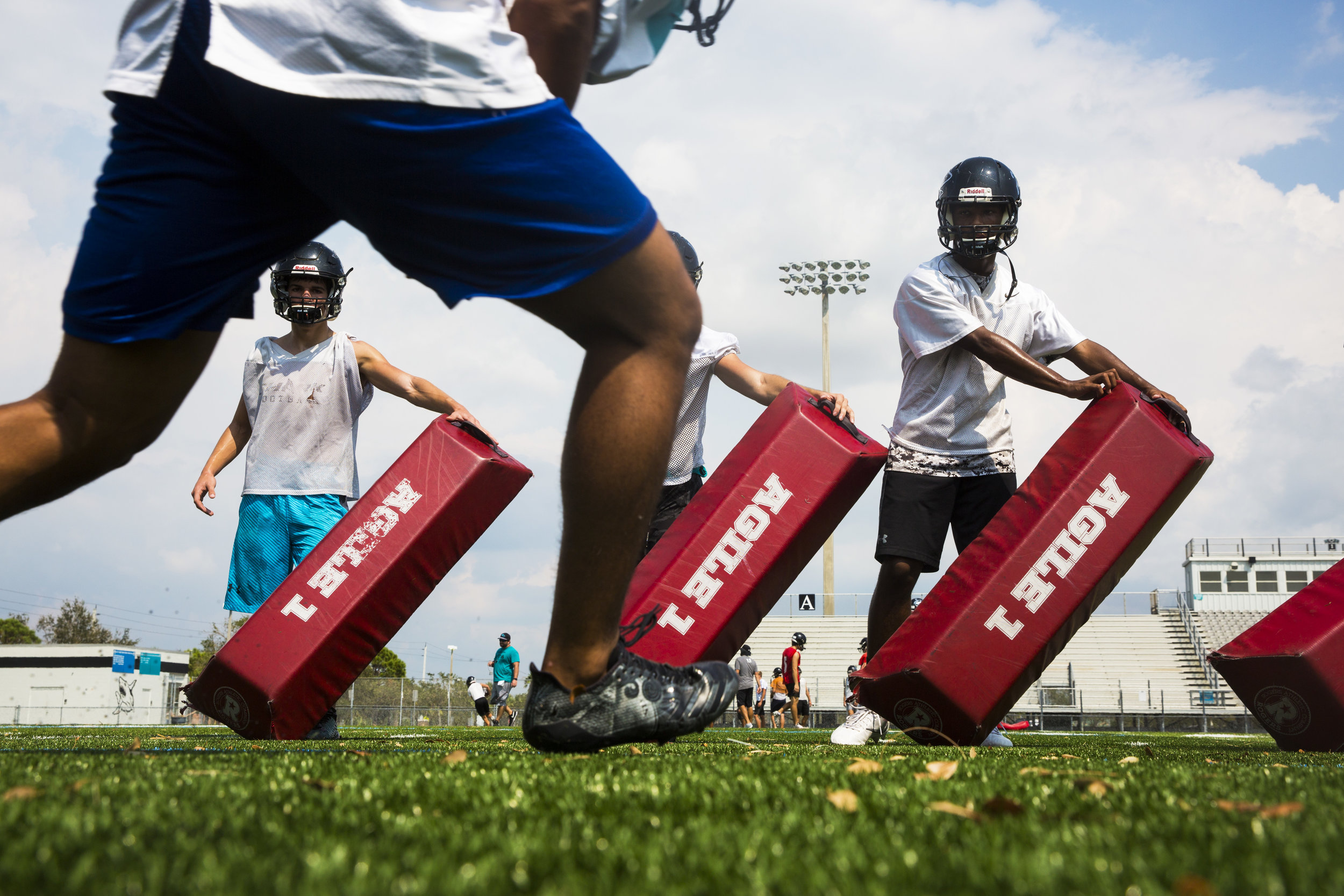 Players run drills during practice at Gulf Coast High School in Naples on Wednesday, Sept. 20, 2017.