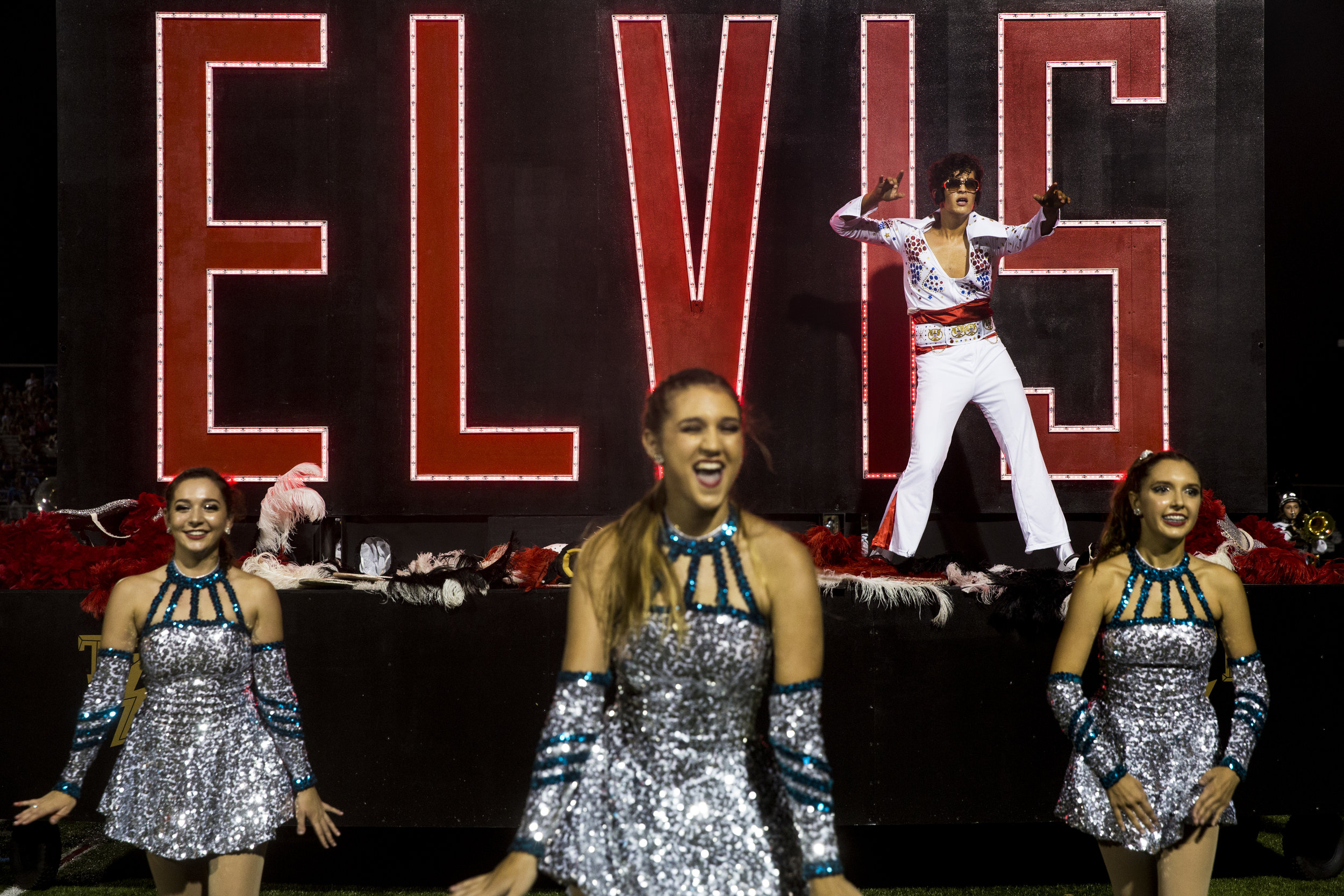 Armond Procacci, top right, strikes a pose as Elvis while performing with the Gulf Coast High School marching band during the halftime show of the Catfish Bowl at Gulf Coast High School in North Naples on Friday, Oct. 6, 2017.