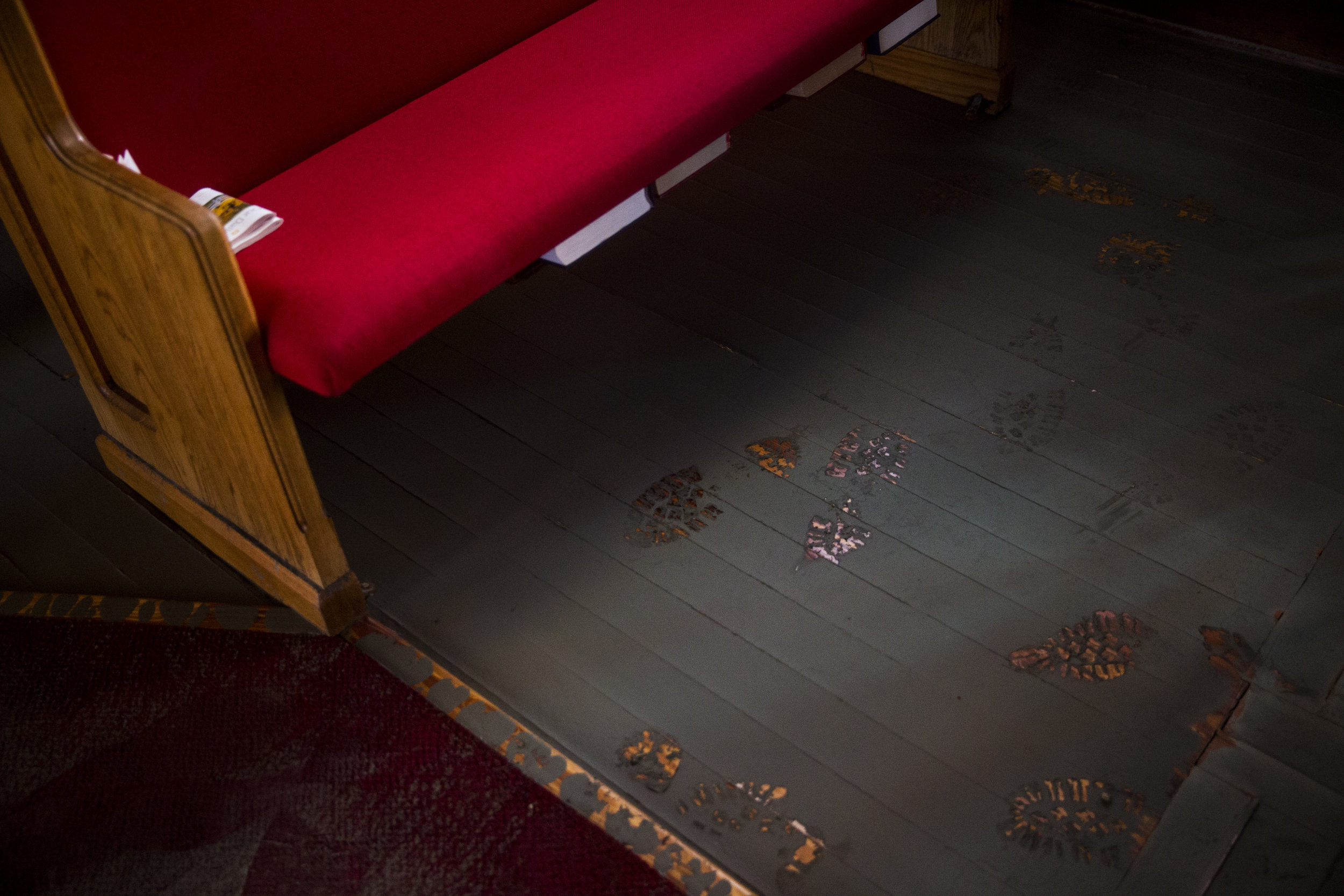 Boot tracks mark the dried mud on the floor of Everglades Community Church on Sunday, Sept. 17, 2017, one week after Hurricane Irma.