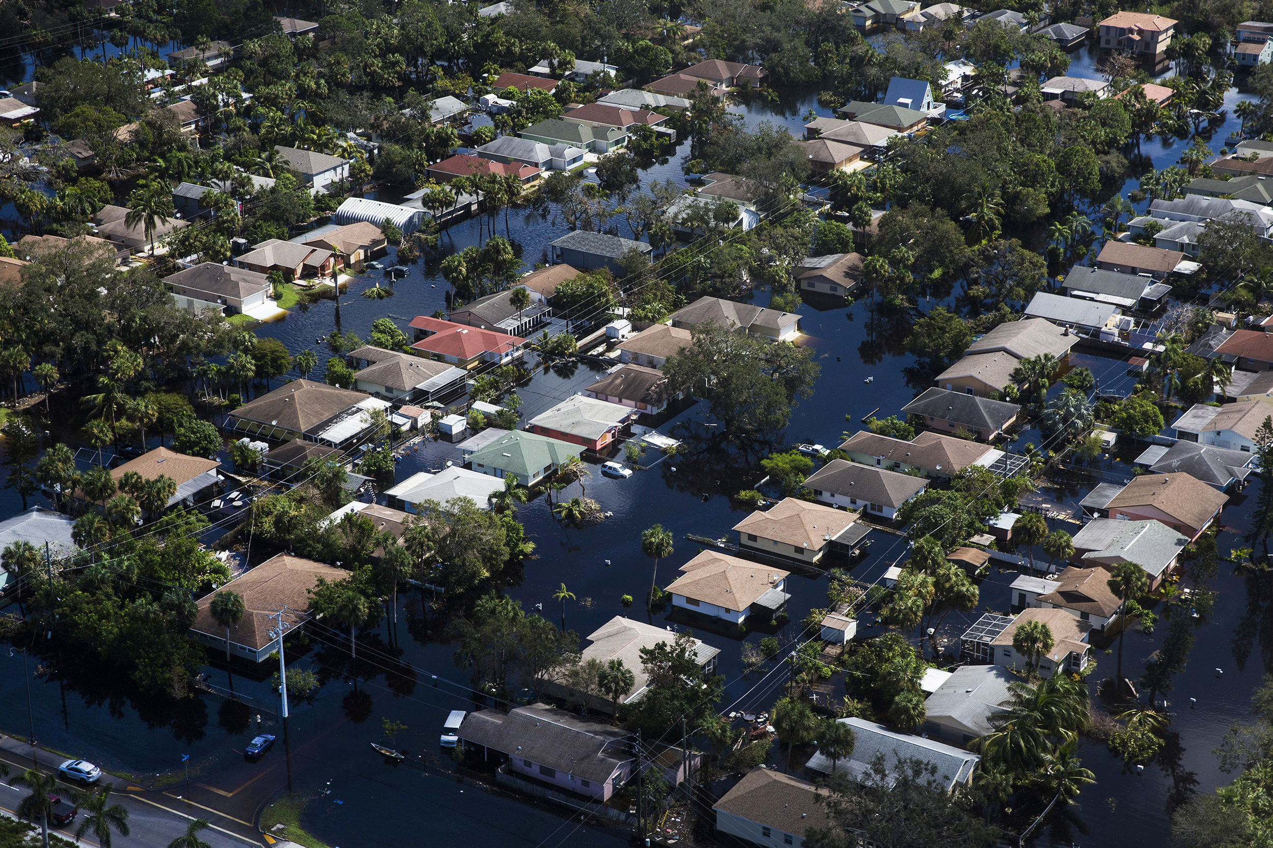 The five streets that make up the Quinn Street area in Bonita Springs remain flooded on Saturday, Sept. 16, 2017, six days after Hurricane Irma. This is the second time in two weeks that the neighboring Imperial River flooded the residential area.