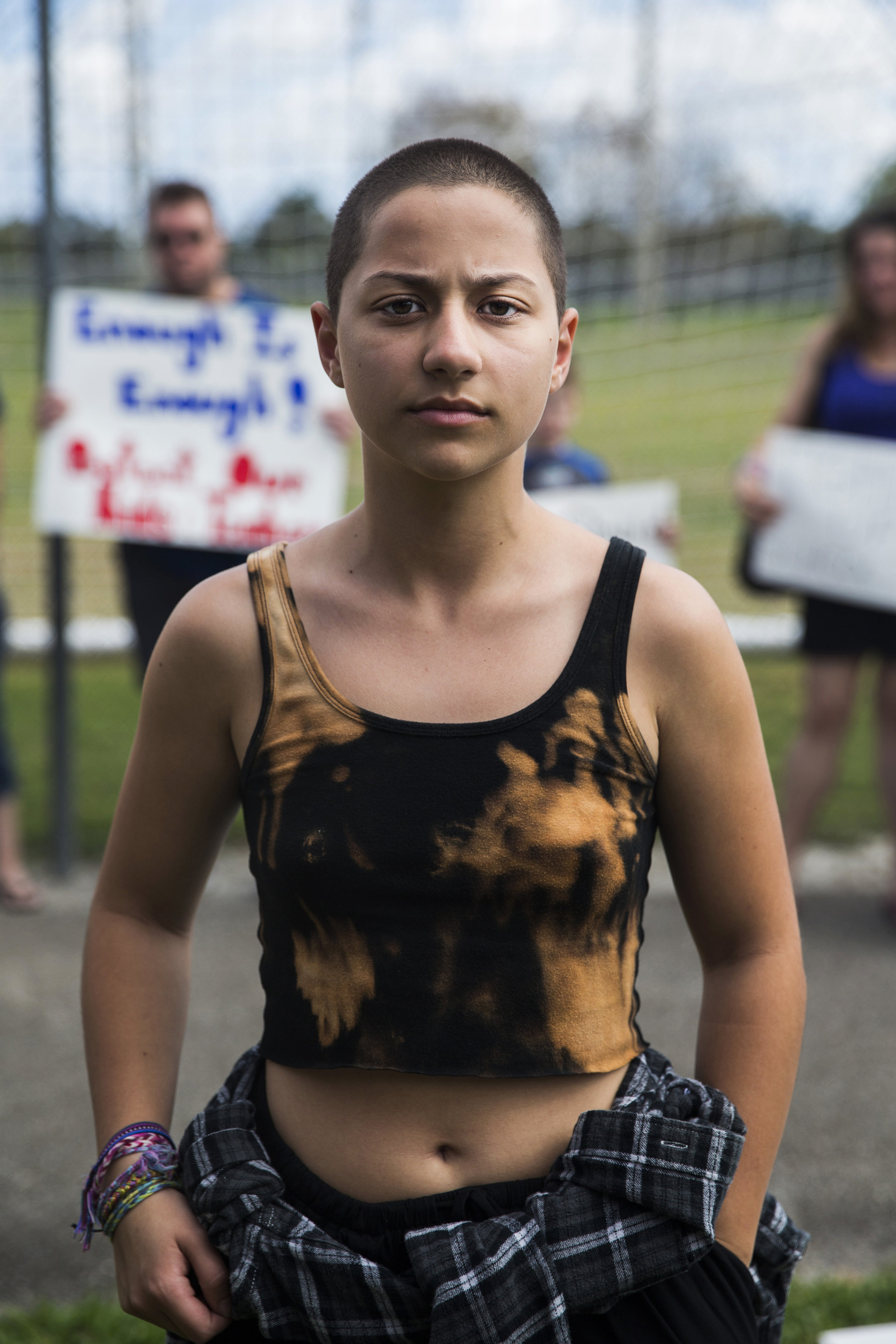 "Emma González, 18, a senior at Marjory Stoneman Douglas High School, at North Community Park on Sunday, Feb. 18, 2018. González became a viral sensation after videos of her impassioned speech at an anti-gun rally in Fort Lauderdale flooded social media. Now, she is helping to lead the #NeverAgain movement with her fellow classmates. ""It's funny. I didn't even have a Twitter account before two hours ago and it was trending on Twitter all day yesterday,"" González said. ""I have become somewhat of a spokesperson for this, but we're all saying the same thing. That's why we teamed up together like this because we know each other, we love each other very much and we all agree on the same stuff. We're happy that all of us are still alive and we're gonna make sure it stays that way for the people in our neighboring communities. For our neighbors, our cousins, this generation, not the next generation because the next generation will never have to worry about this because of us."""