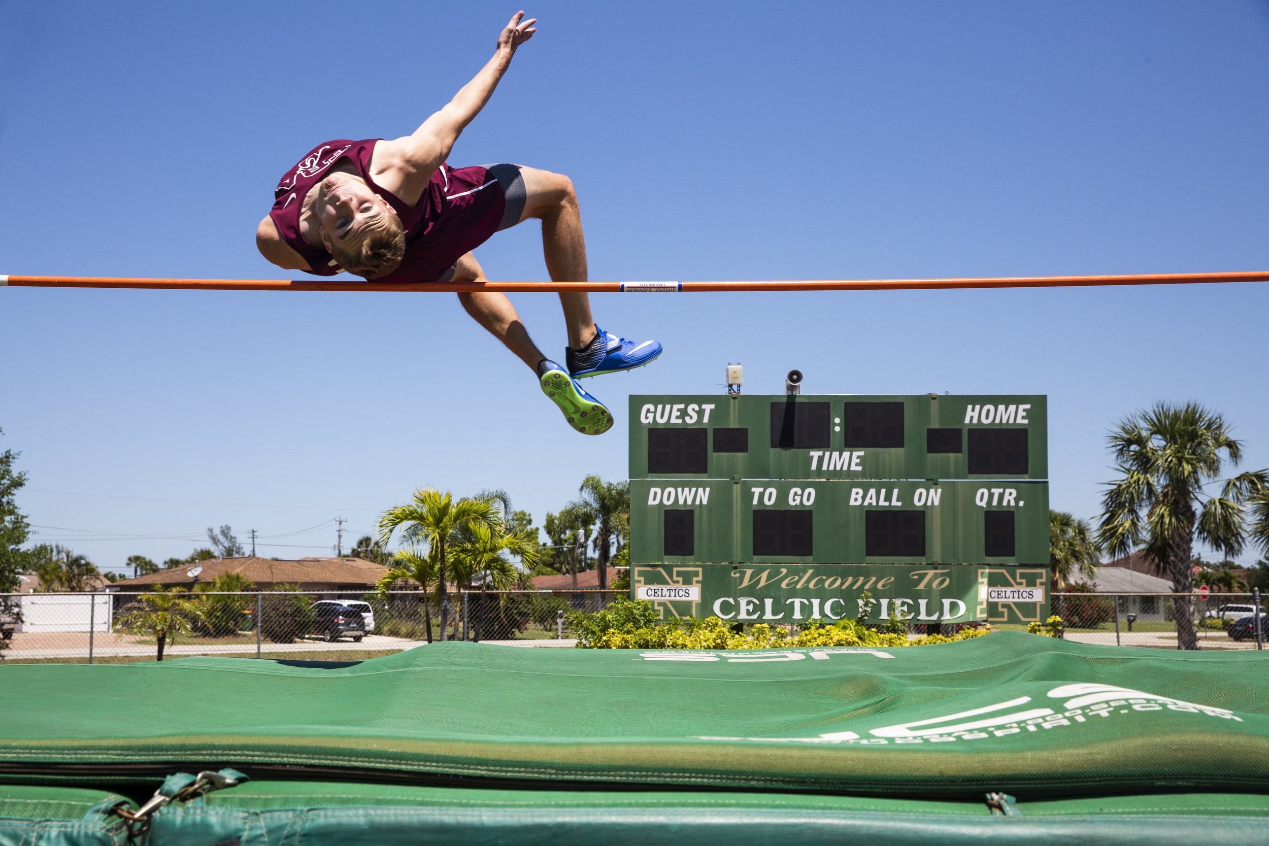 Nick Tompkins, from First Baptist Academy, competes in the high jump during the Class 1A District 8 track and field meet at St. John Neumann Catholic High School on Tuesday, April 17, 2018.