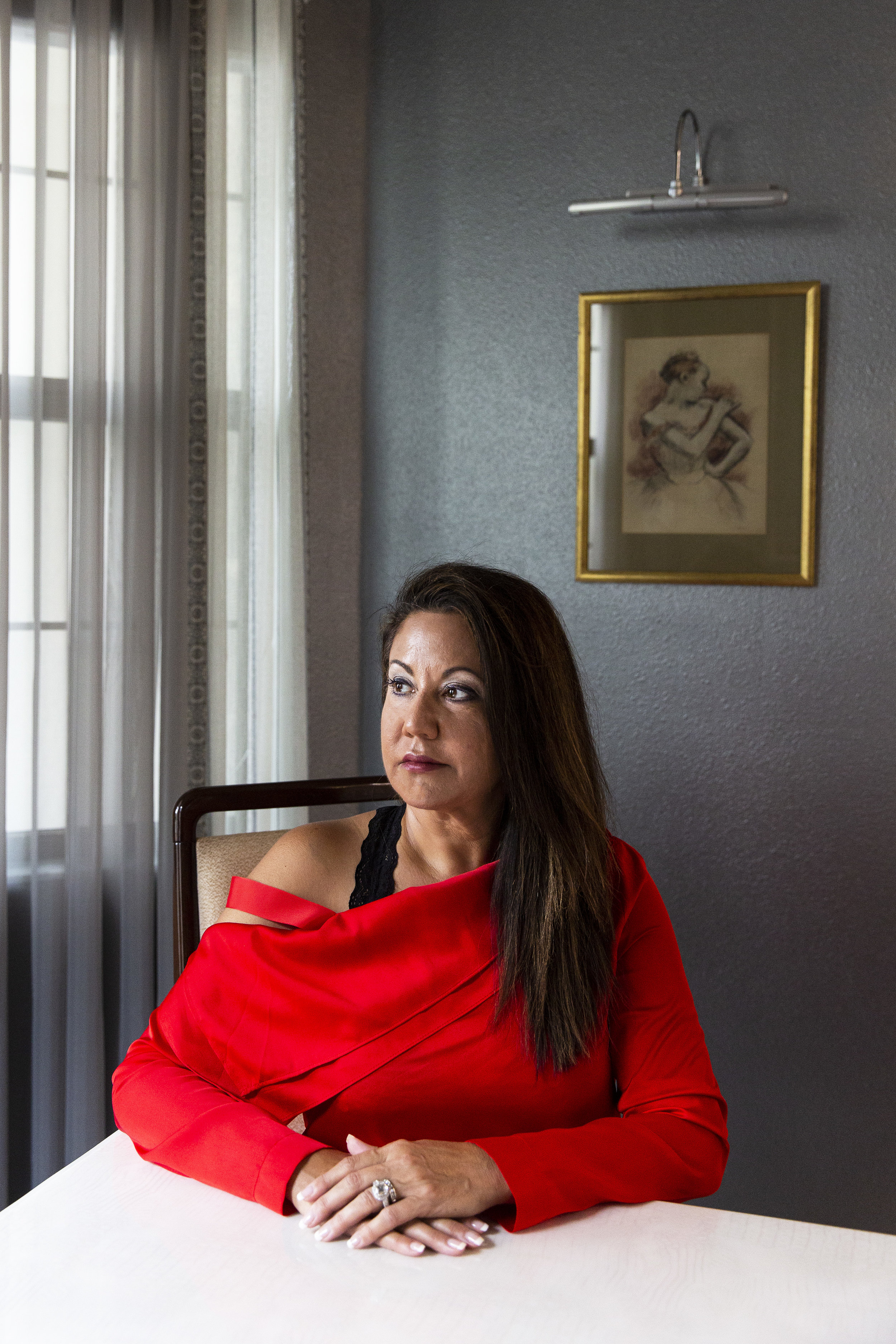"Amal Bernal at her home in North Naples on Wednesday, August 1, 2018. Bernal's ex-husband abused her physically, emotionally and financially for twenty years. Financial abuse, defined as 'coercive control' by the Centers for Disease Control, is often the unseen and debilitating perpetuation of all other types of abuse. ""To me, it's just as bad as any other kind of abuse because it's how they control you,"" Bernal said."