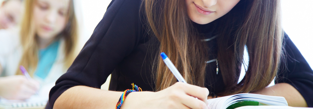 Girl Taking Test – What's New on the Redesigned SAT?