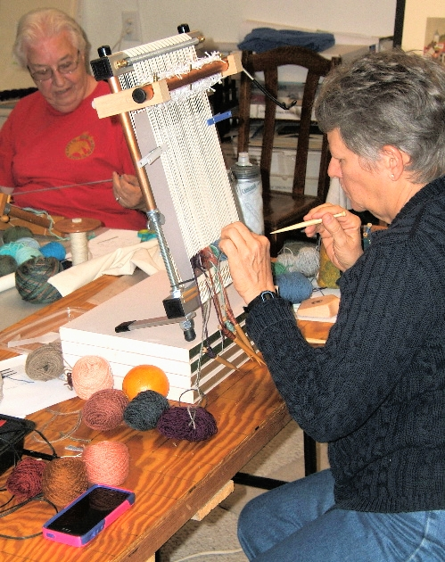 Maddie and Lavonne (n background) at their looms