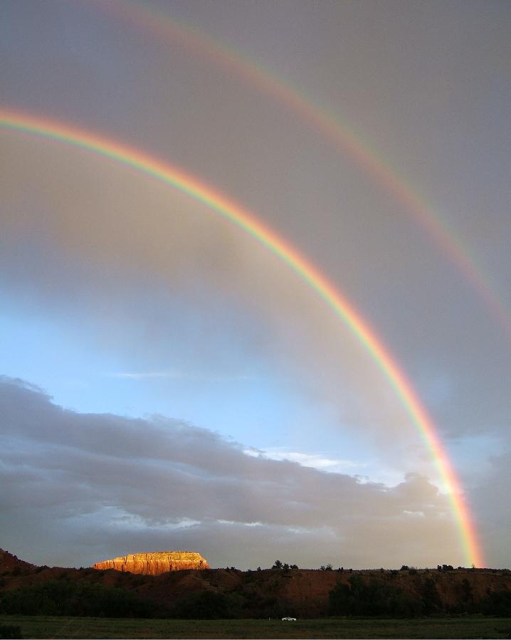 Sunset, double rainbow after the storm photo credit: Elizabeth J. Buckley