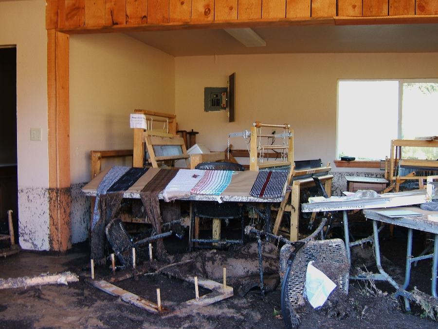 Interior view of studio, Suzanne Halvorson's scarves draped on front table photo credit: Elizabeth J. Buckley