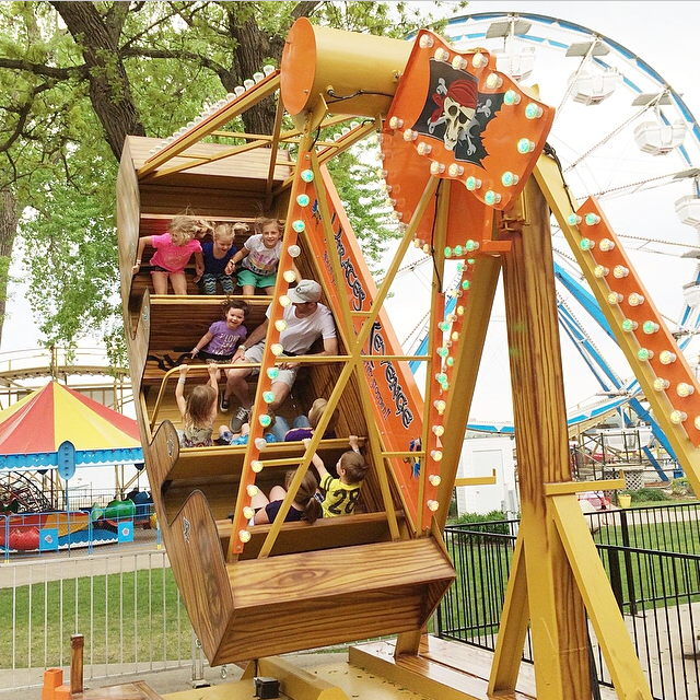 I couldn't believe she wanted to ride this OR that she was in fact tall enough to go by herself. The operator dude suggested that Eric chaperone her but poor guy really didn't want to. Roo drug him on this one twice! Next time I say my child is cautious, remind me of this. Go Roo!