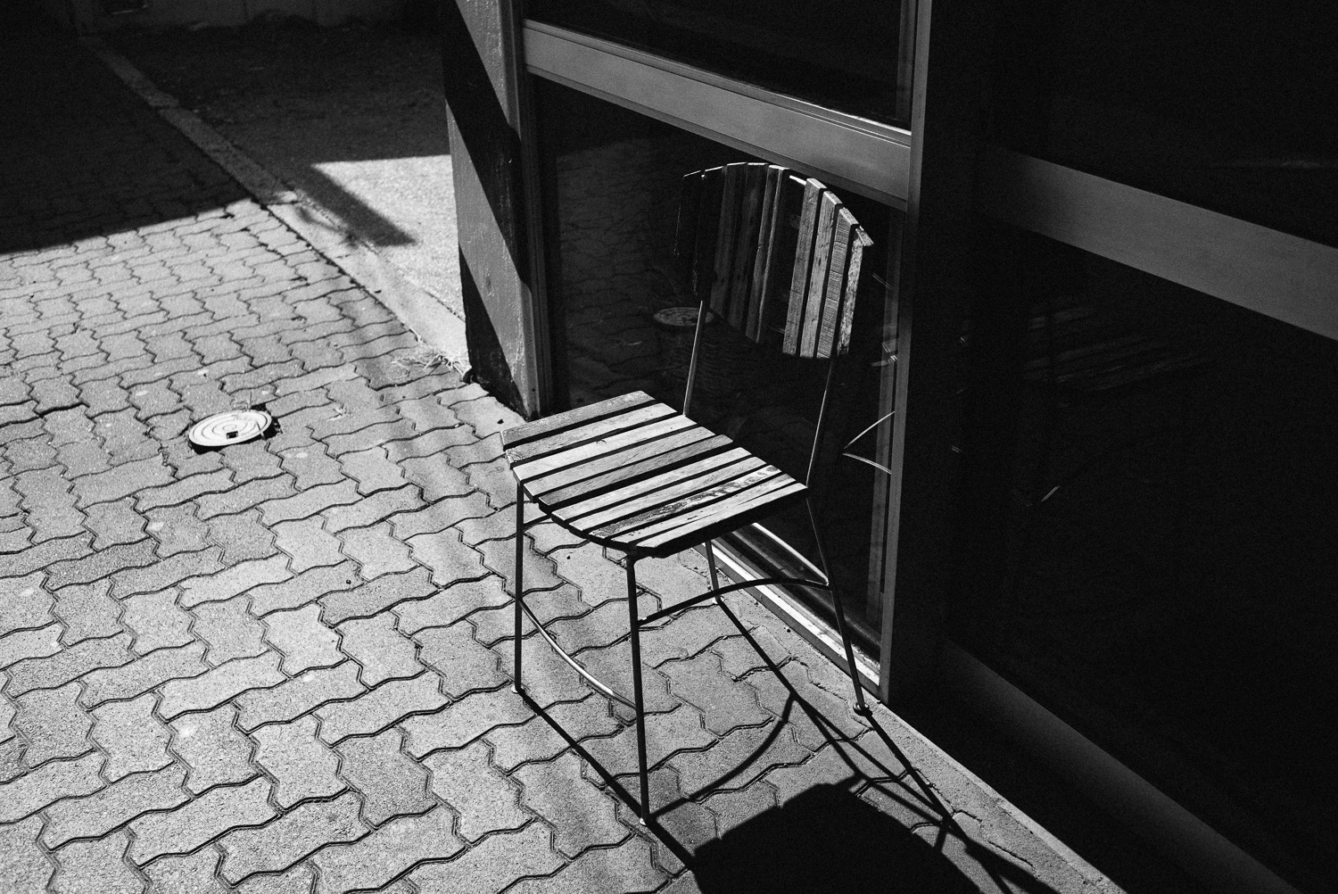 A chair basking in the sun, trying to get it's tan on.