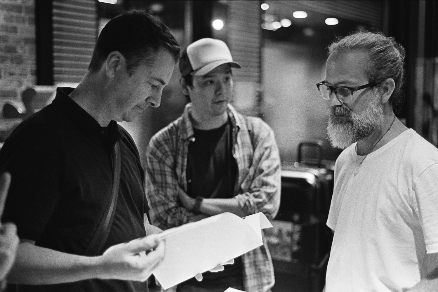 Mark, Rocky and Simon taking a look at a new photo book.