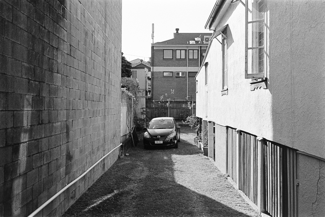 Cars in driveways.