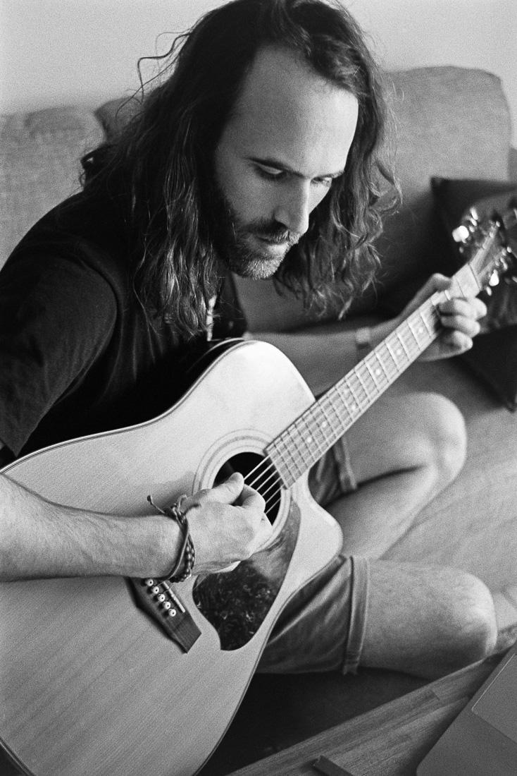 Tom playing guitar.