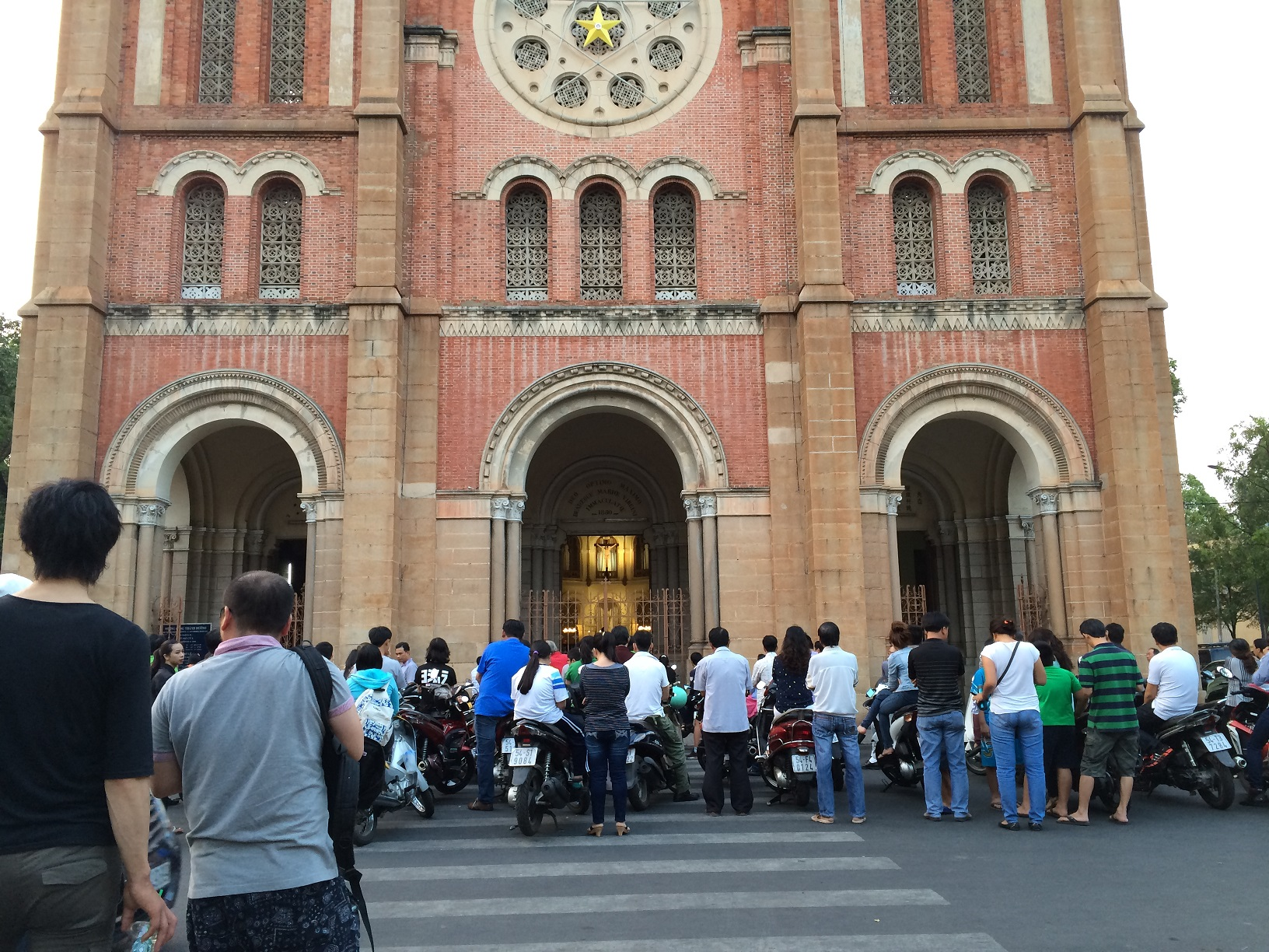 Attending mass at the Saigon Notre-Dame Basilica in HCM City