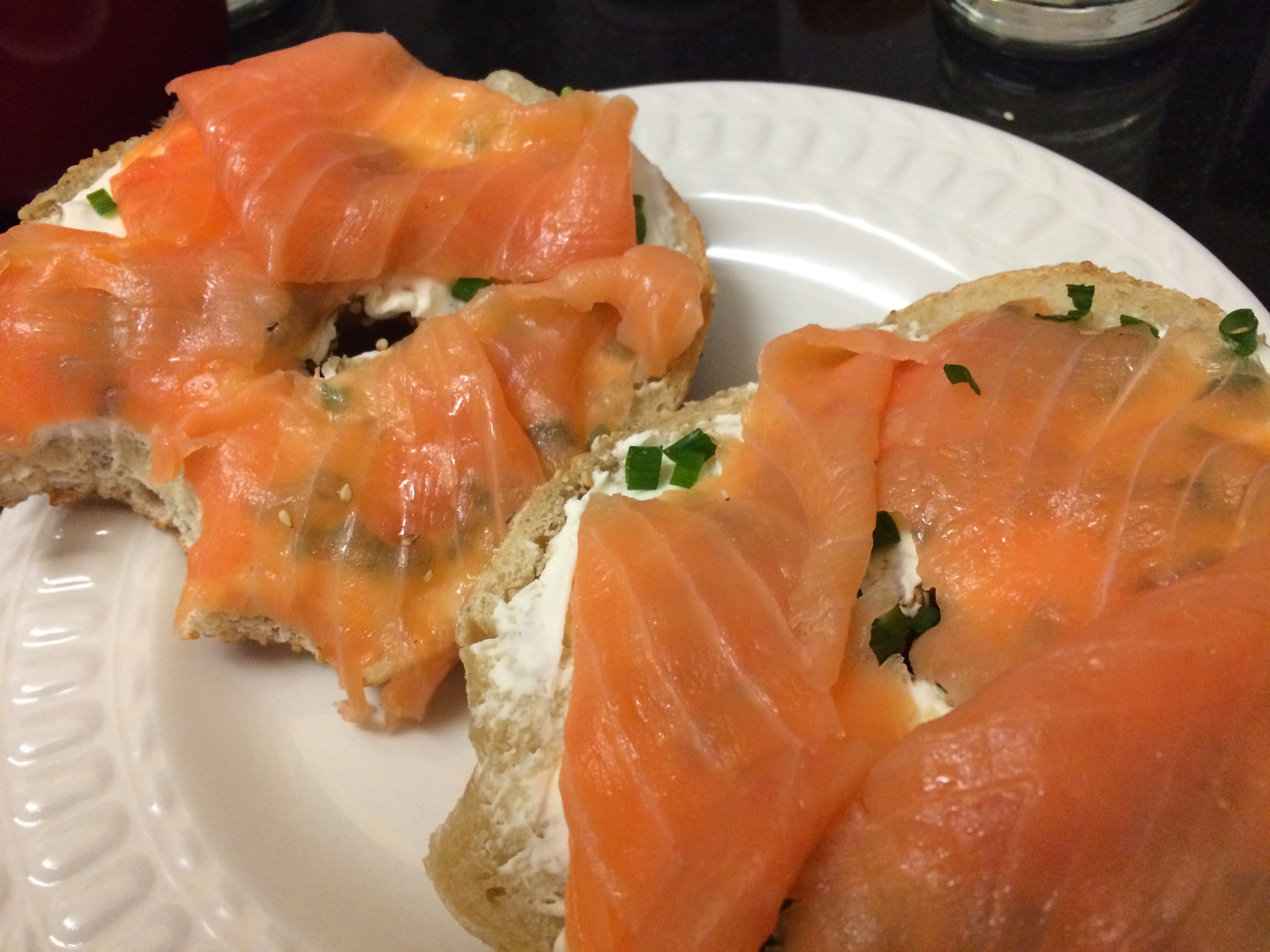 Sesame seed bagel, cream cheese, chives, and lox