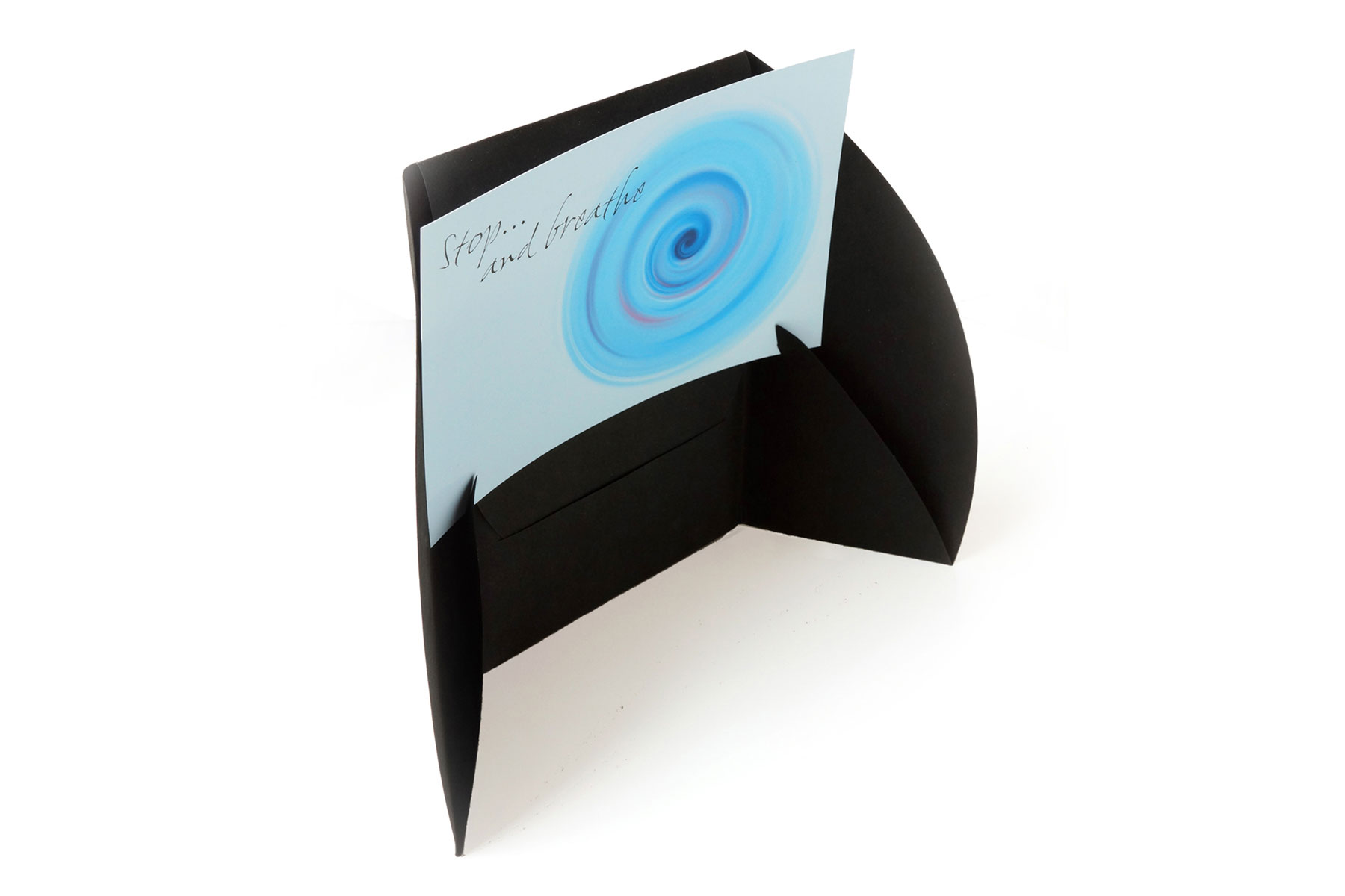 The stand allows the cards to be held upright and viewed at eye level, thus encouraging more their more frequent use.