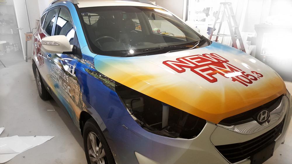 new-fm-car-wrap-progress-think-graphic-communication.jpg