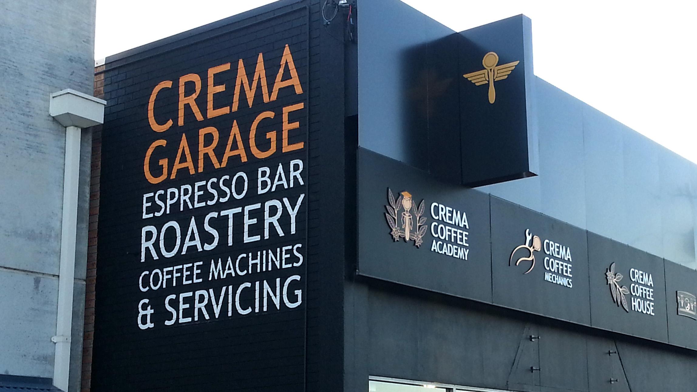 crema garage hand painted sign on wall.jpg