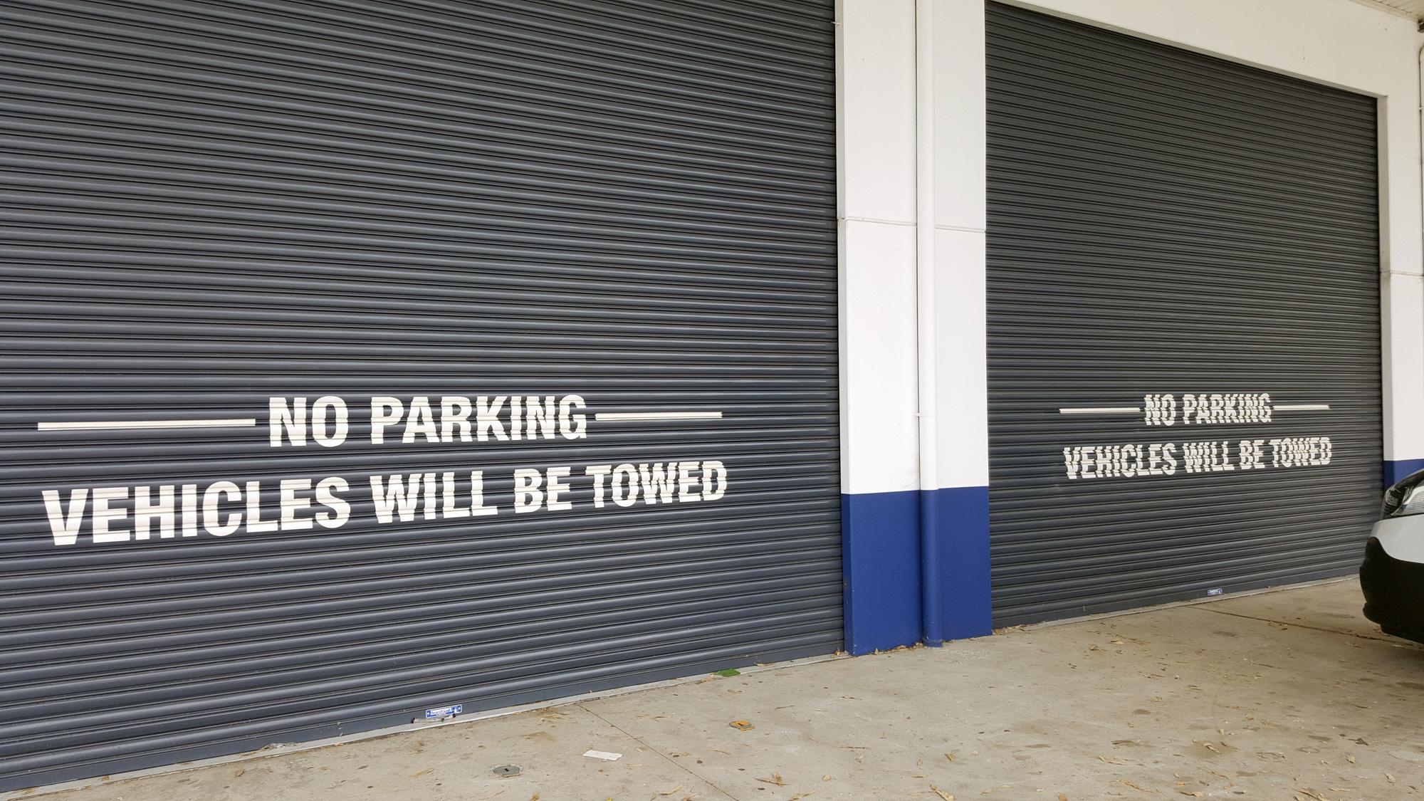 roller door signs