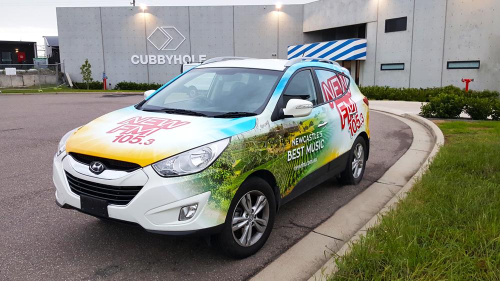newfm-fleet-car-think-graphic-communication-passenger-side.jpg