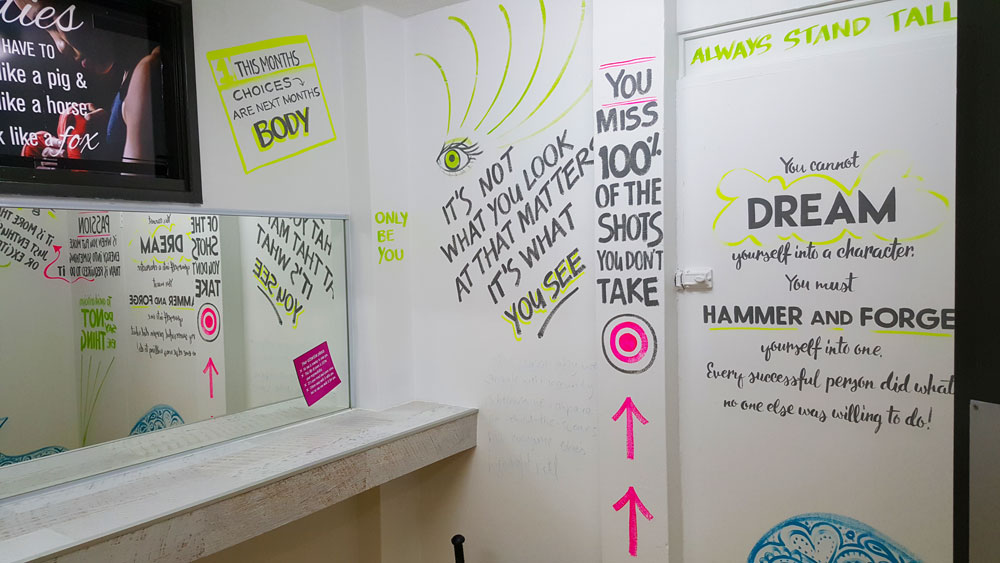 the-concept-gym-interior-hand-painted-signs-in-womens-toilets.jpg