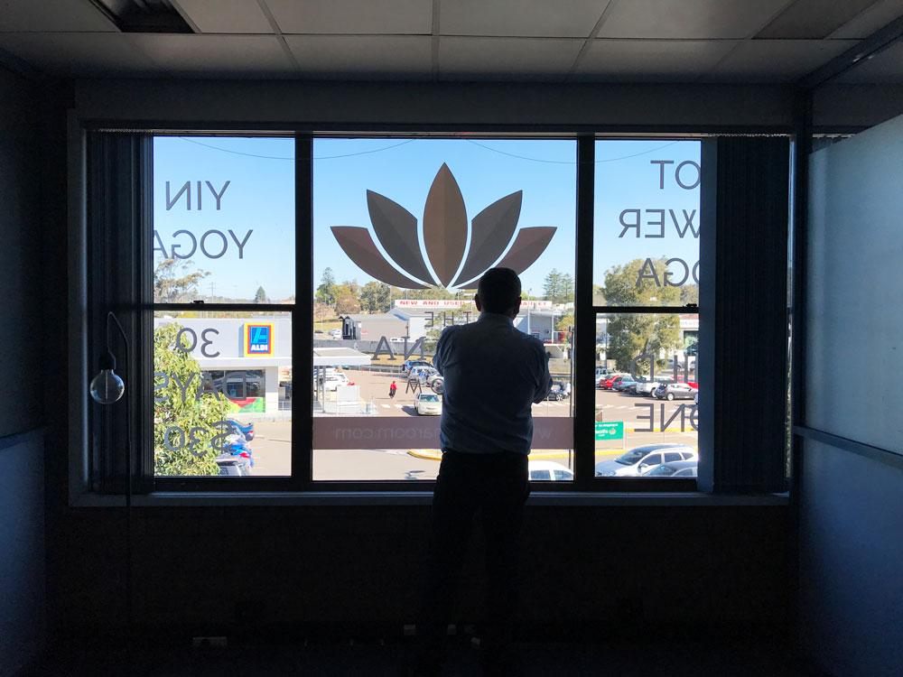 royce-at-ohana-applying-window-graphic-silhouette.jpg