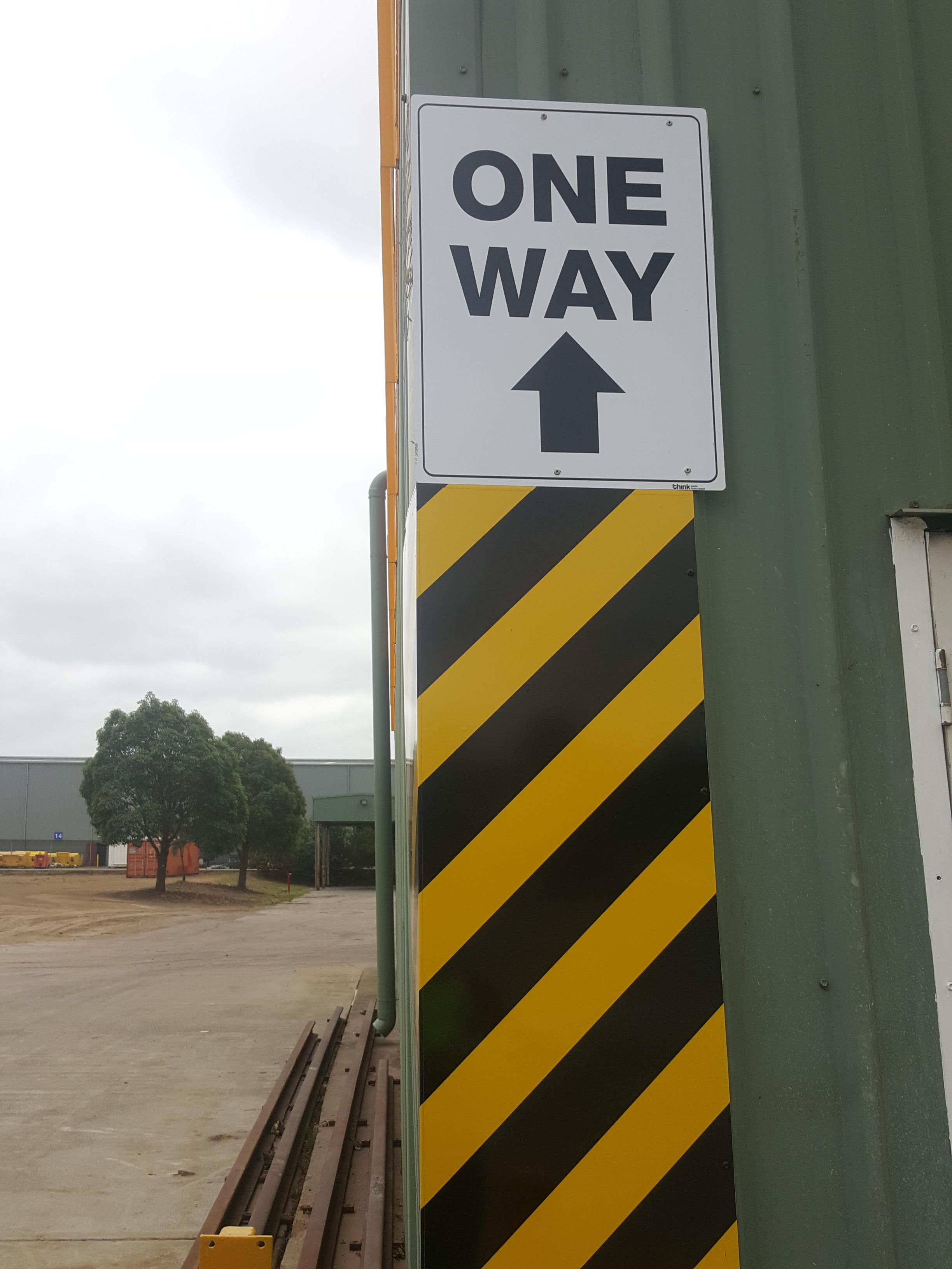 think graphic communication  Bis signs chevron custom made barriers.jpg