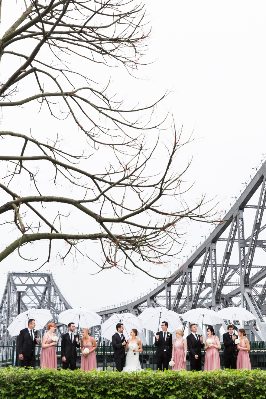 Bridal party with umbrellas at the Brisbane Story Bridge