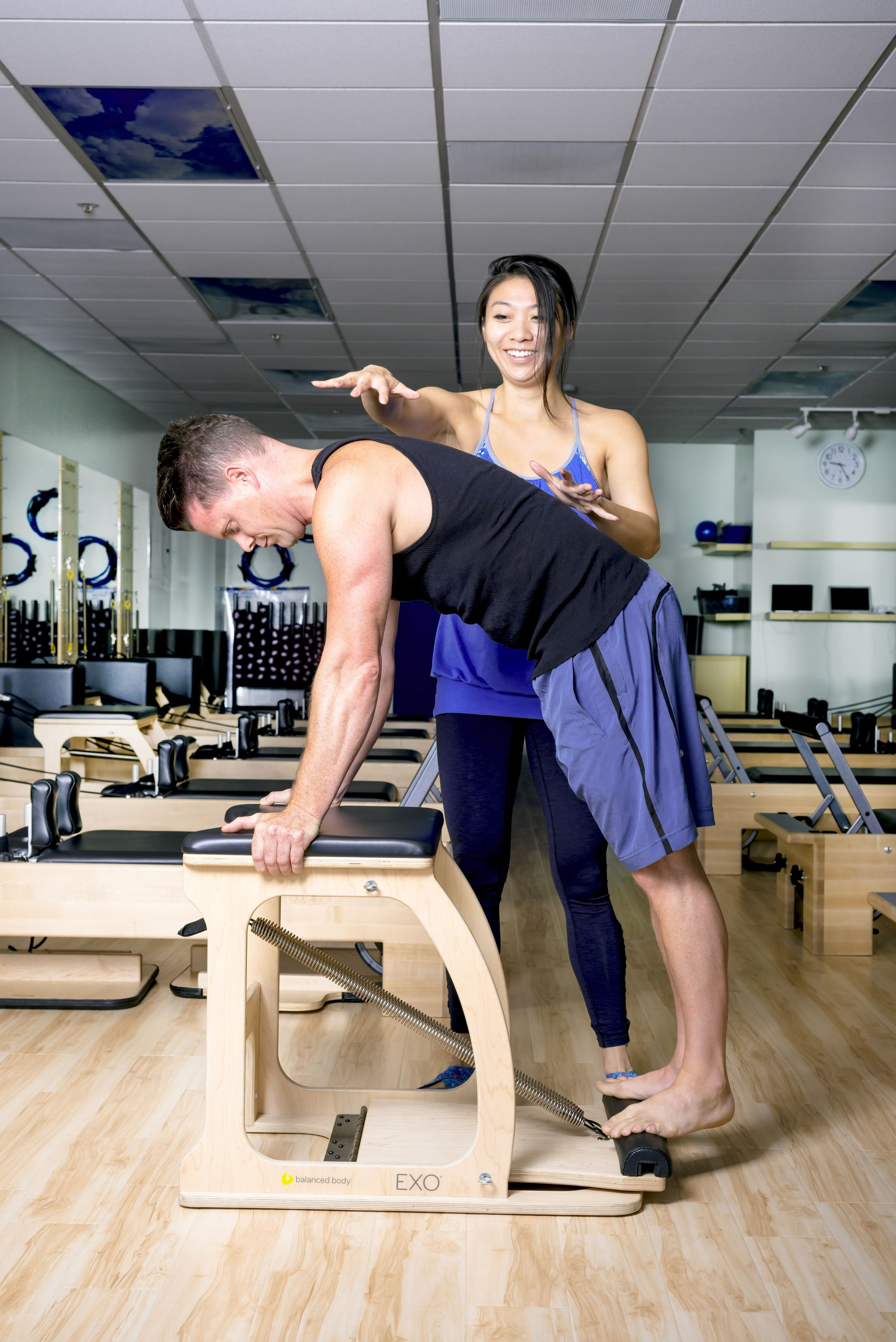 pilates v__man on chair with instructor.jpg