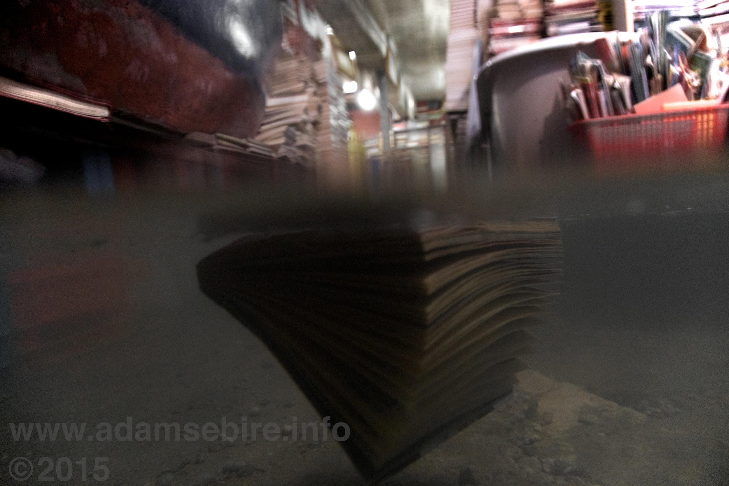 Venice acqua alta bookshop underwater during high tide flooding