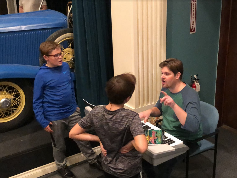 """RPAA Director, Aaron Smith, offering Voice feedback during the production """"A Christmas Story: The Musical""""."""