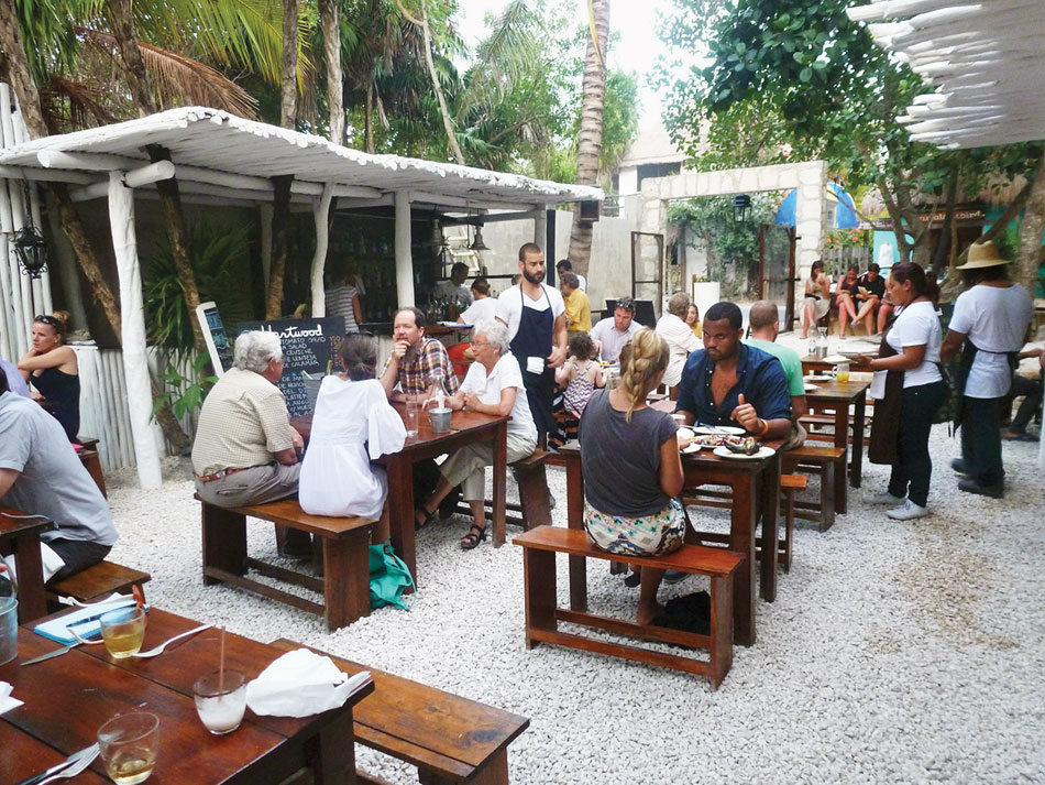 diners-in-the-openair-restaurant-hartwood-are-steps-away-from-the-white-sand-beach-in-tulum.png