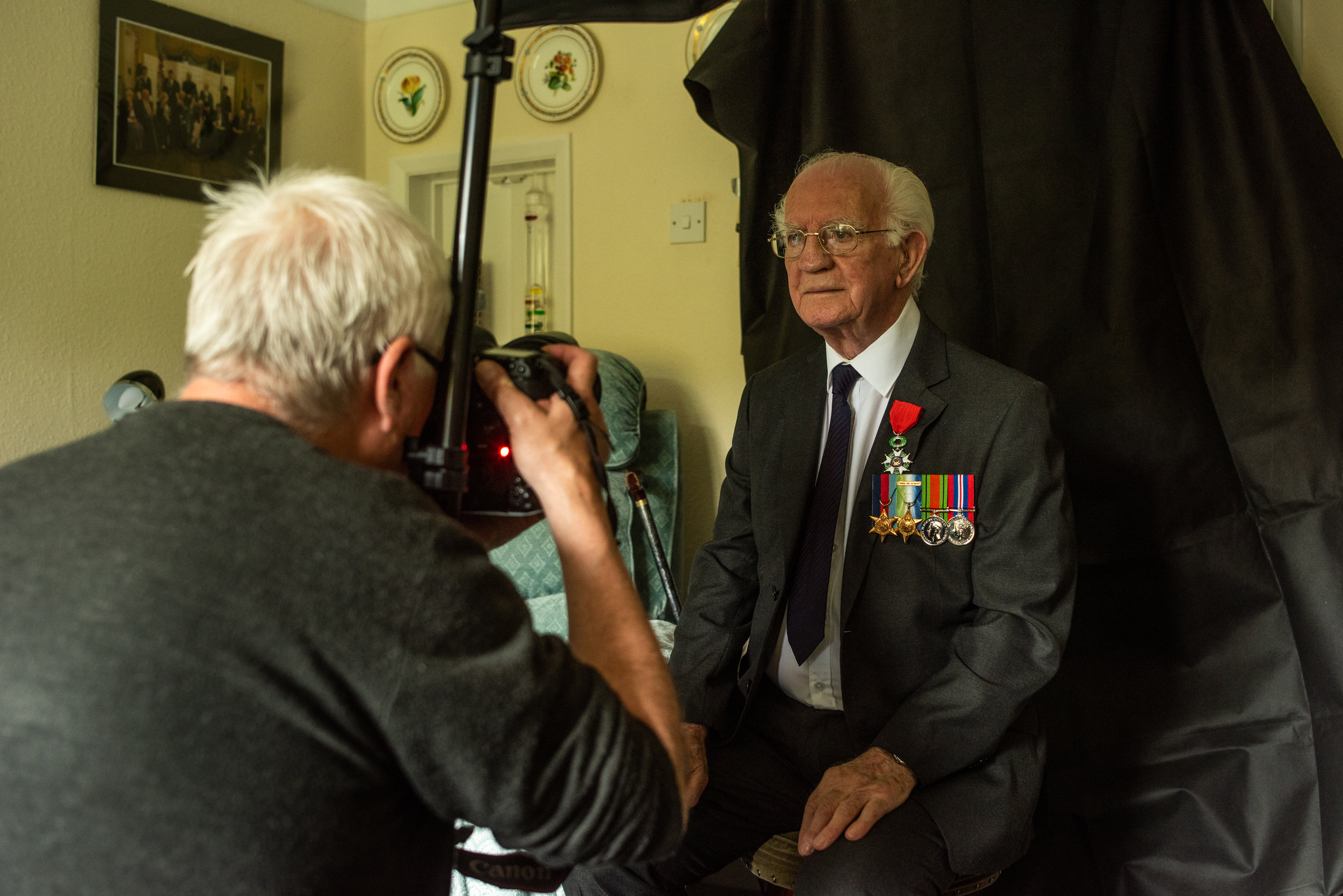 Phillip Raymond Sweet, 83, sub leftennont, was born in Stratford, went to KES and walked his daughter down the isle at Holy Trinity Church. Being photographed by local press photographer Mark Williomson for a pice on D-Day.